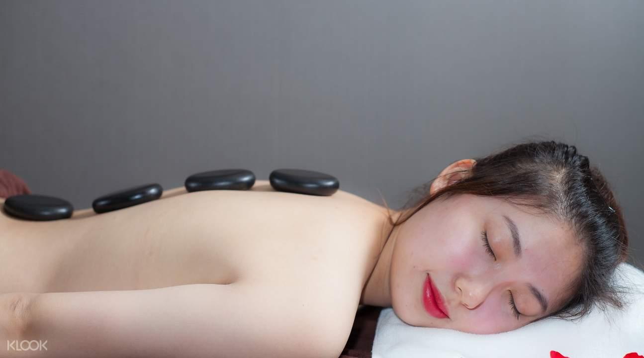 lady guest enjoying a massage treatment